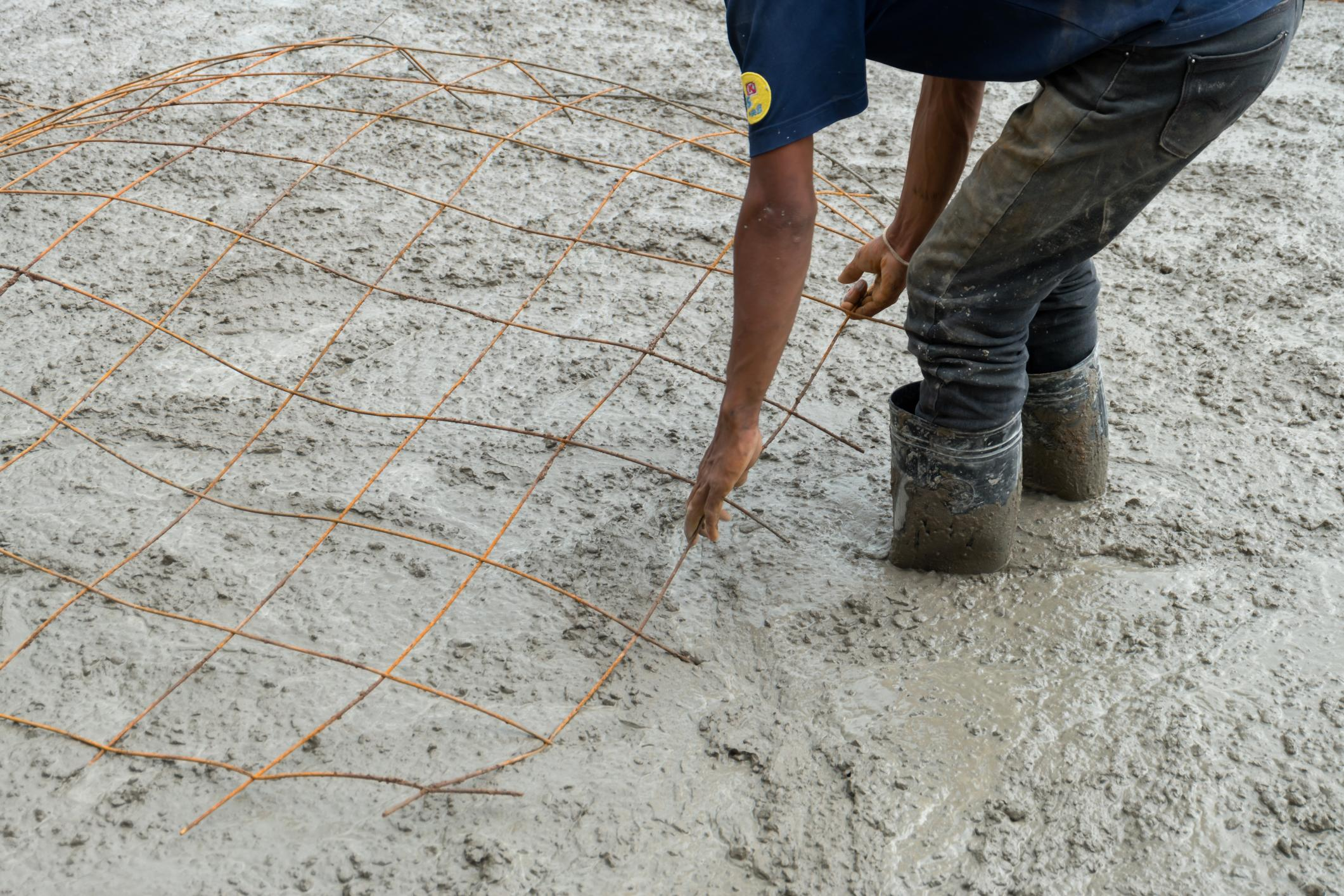 A Worker Reinforcing Concrete